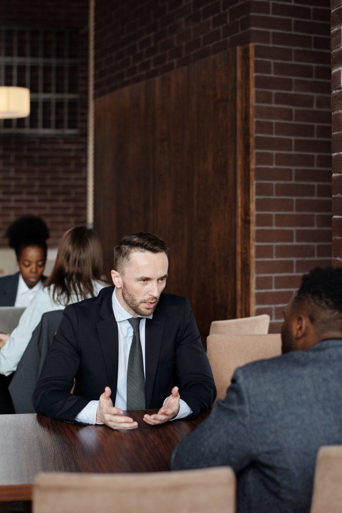 Man consulting a lawyer regarding an infringement of a trademark