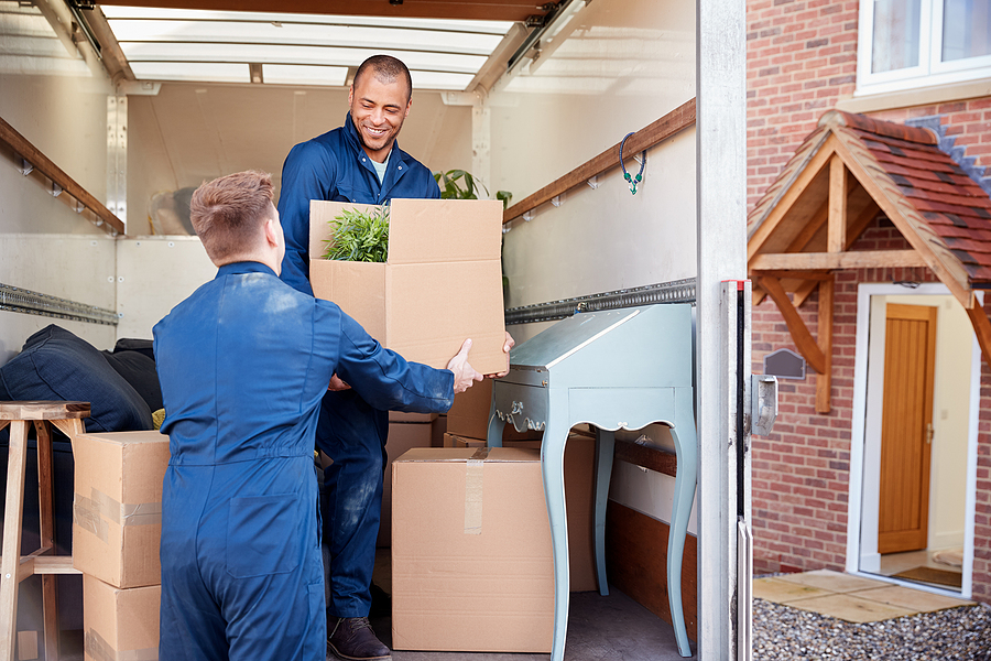 Premium removalists unloading furniture and boxes