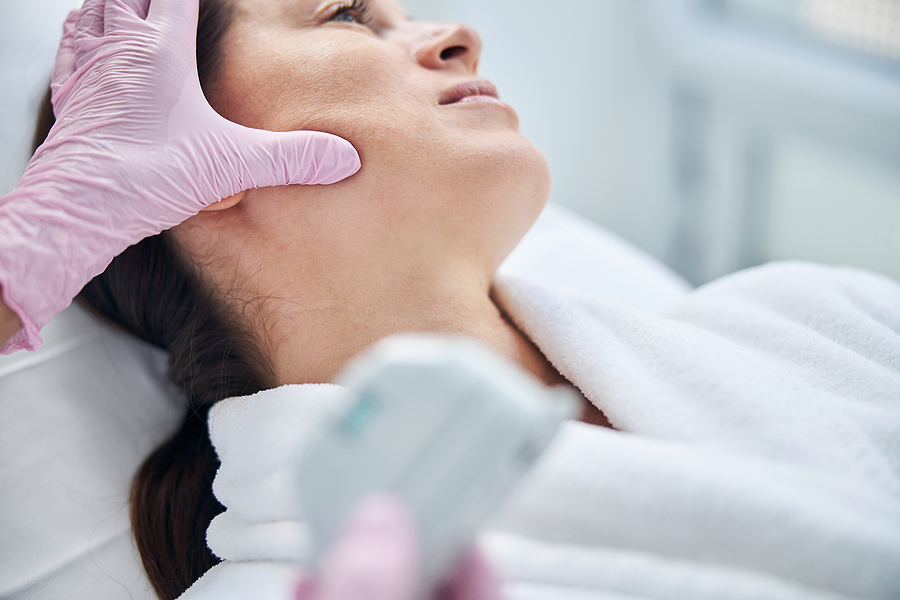 Female patient undertaking a mole mapping procedure