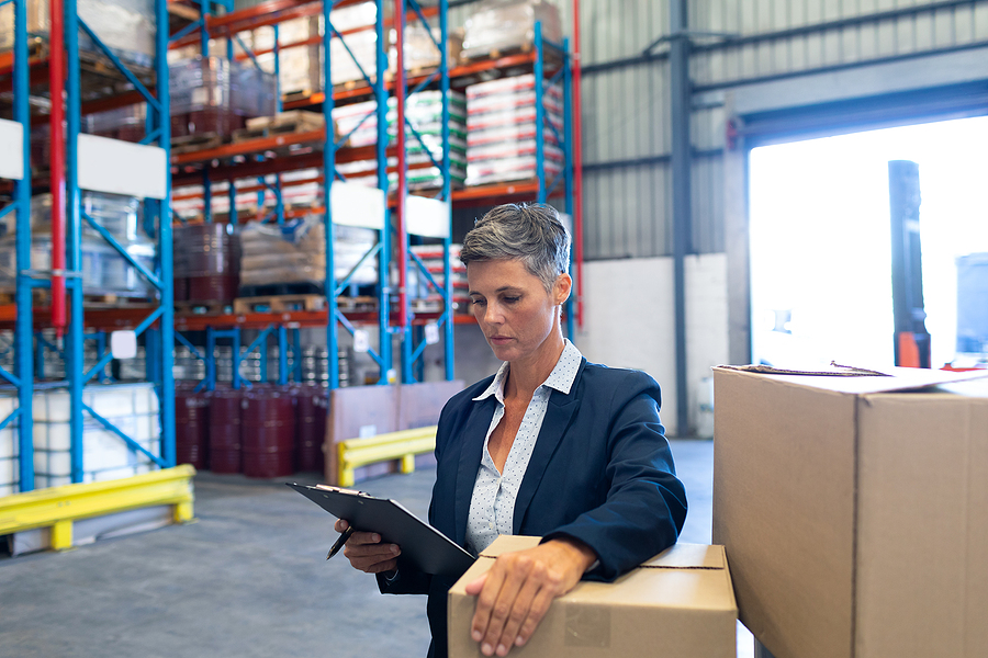 Female manager of a 3PL Sydney company doing an inventory