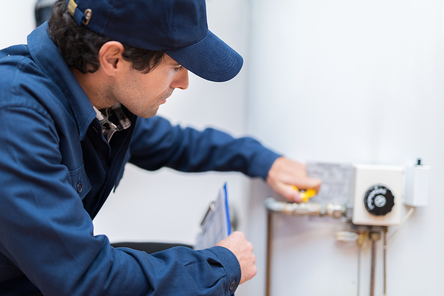 Hot water plumber in Canberra repairing a water heater