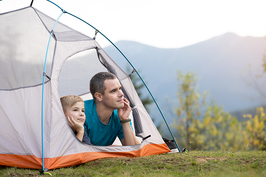 Young father and his child son inside the best hiking tent