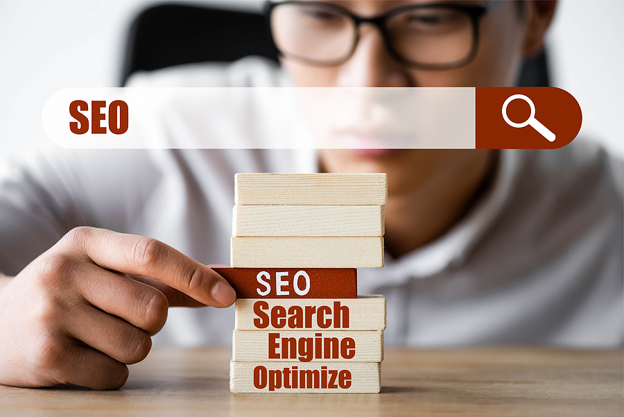 Man and wooden blocks with SEO