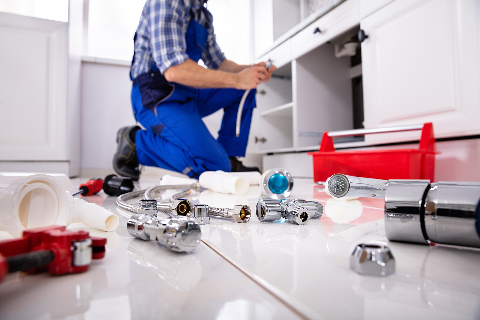 Plumber in Wellington and his tools on the floor