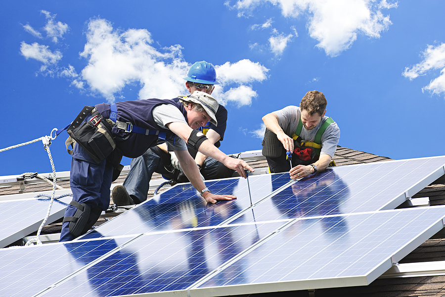 Three specialists installing commercial solar systems